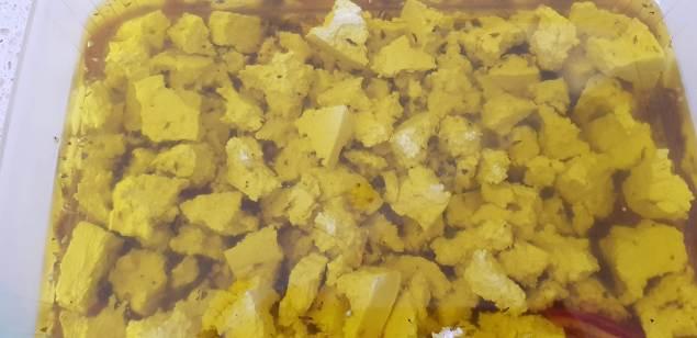 Tofu marinating to become vegan feta